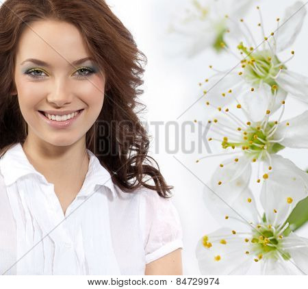 closeup portrait of attractive  caucasian smiling woman brunette isolated on white studio shot toothy smile looking at camera tooth spring flowers