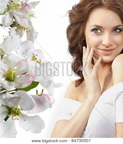 closeup portrait of attractive  caucasian smiling woman brunette isolated on white studio shot lips smile face hair head and shoulders skin spring flowers