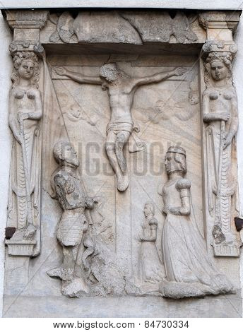 GRAZ, AUSTRIA - JANUARY 10, 2015: Crucifixion on the Graz Cathedral dedicated to Saint Giles in Graz, Styria, Austria on January 10, 2015.