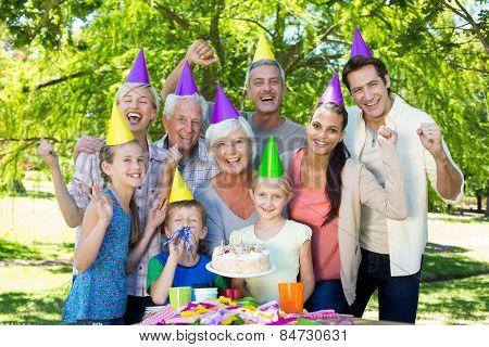 Happy family celebrating a birthday on a sunny day