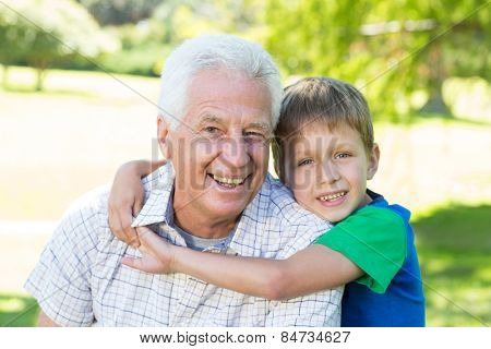 Happy grandfather with his grandson on a sunny day