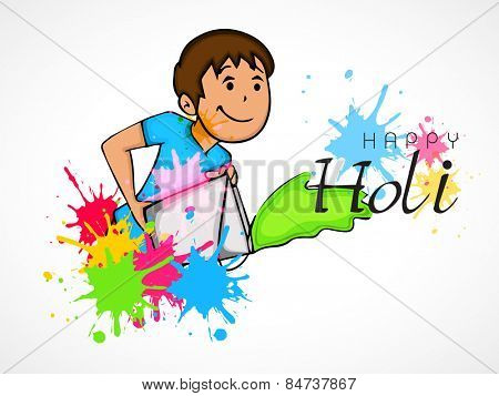 Cute little boy throwing color from a bucket on occasion of Indian festival, Happy Holi celebration.