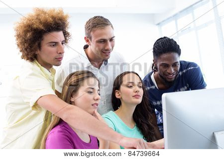Portrait of smiling students in computer class