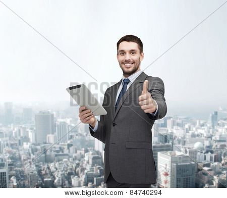 business, communication, modern technology and office concept - smiling buisnessman with tablet pc computer showing thumbs up