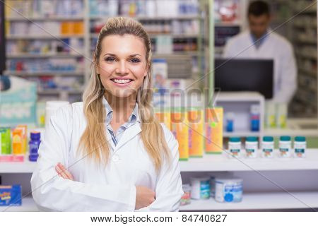 Pharmacist smiling at camera at the hospital pharmacy