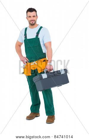 Smiling carpenter with toolbox on white background