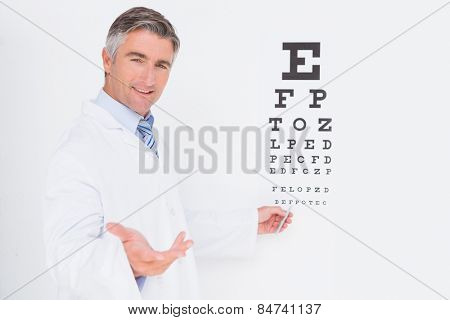 Optometrist looking at camera in medical office