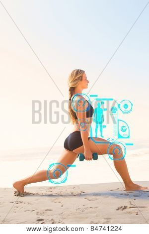 Fit blonde doing weighted lunges on the beach against fitness interface