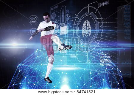 Football player in white kicking against glowing sphere on black background
