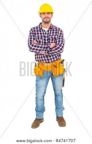 Manual worker standing arms crossed on white background