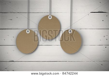 Circle tag hanging against white wood