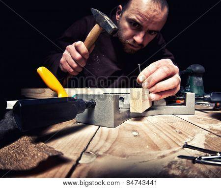 diy carpenter on duty dark background