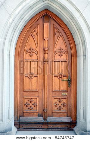 arch wood door in Switzerland