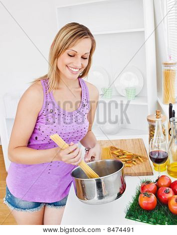 Merry Woman Cooking Spaghetti At Home
