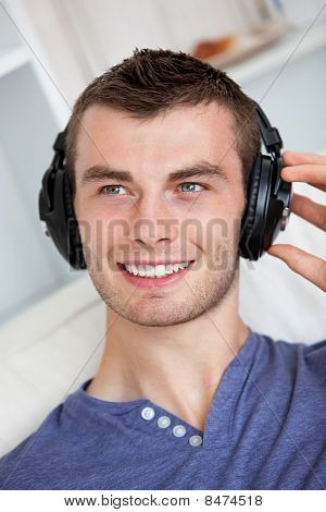 Handsome Young Man Listening To Music With Headphones