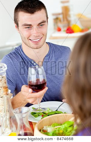 Charming Young Man Having Dinner