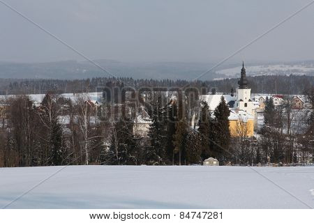 Winter landscape with the village of Jindrichovice in the background in Western Bohemia, Czech Republic.