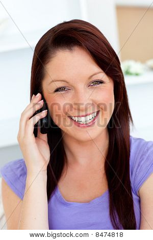 Laughing Young Woman Talking On Phone At Home