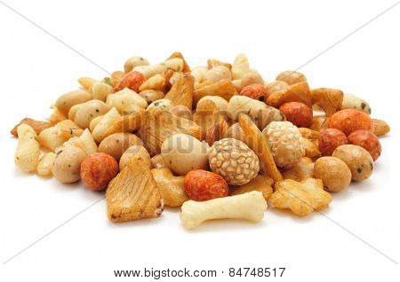 closeup of a pile of oriental mix snack on a white background