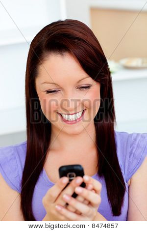 Delighted Young Woman Sending A Text