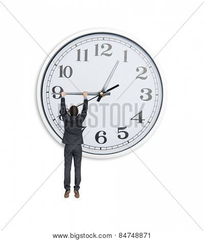man in black suit hanging at clock hand over white background