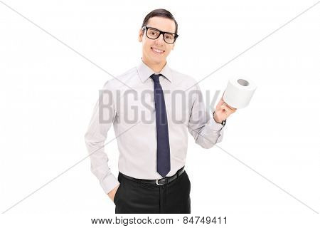 Young businessman holding a toilet paper roll and posing isolated on white background