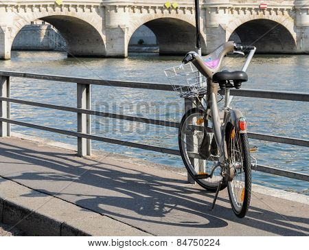 PARIS, FRANCE - CIRCA AUGUST 2009: A Velib' next to the river Seine. Velib' is a public bicycle sharing scheme