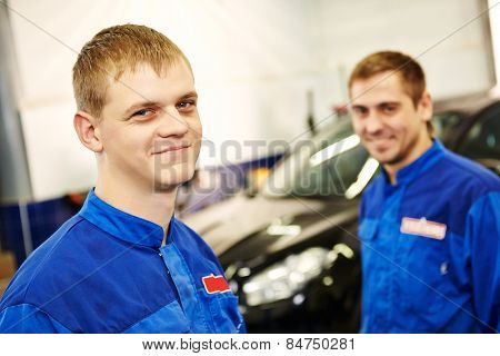 auto repairmenn mechanic portrait in car auto repair or maintenance shop service station