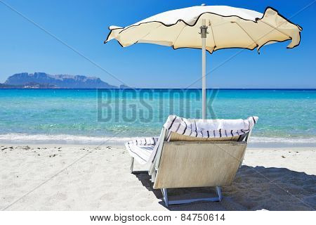 Beach chair with umbrella for rest and relaxation on resort sand beach