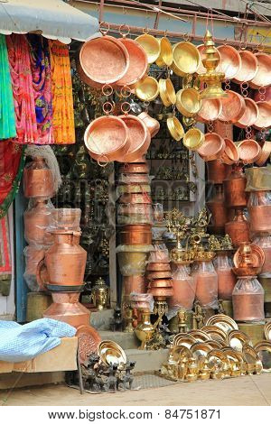 KATHMANDU, NEPAL - APRIL 2014 : Brass pots, copperware and trinkets for sale in Kathmandu, Nepal on 12 April 2014.