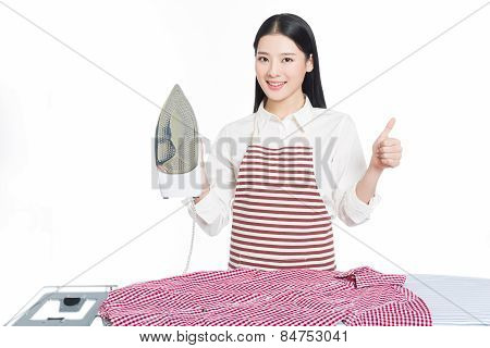 Young Housewife Ironing