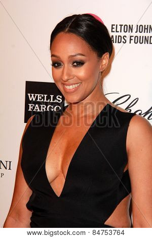 LOS ANGELES - FEB 22:  Tia Mowry at the Elton John Oscar Party 2015 at the City Of West Hollywood Park on February 22, 2015 in West Hollywood, CA