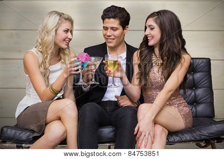 Friends toasting against bleached wooden planks background