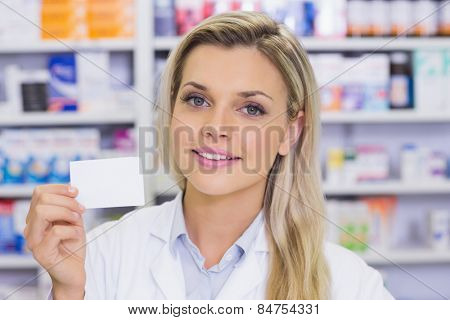 Pharmacist showing medicine box at the hospital pharmacy