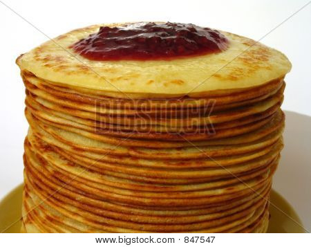 heap of pancakes with home-made jam