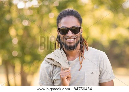 Handsome hipster in the park on a sunny day