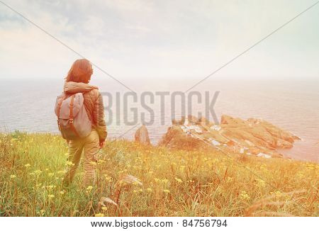 Hiker Woman Looking To The Town On Peninsula