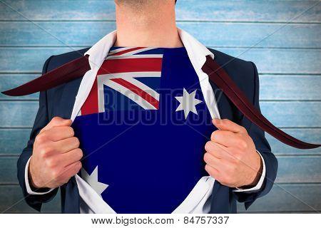 Businessman opening shirt to reveal australia flag against wooden planks