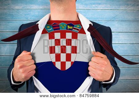 Businessman opening shirt to reveal croatia flag against wooden planks