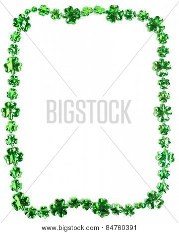 St. Patricks day beads on a white backgound with copy space