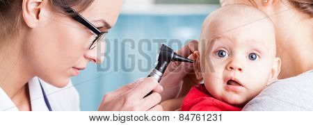 Pediatrician Using Otoscope