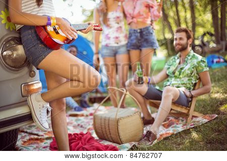 Hipsters having fun in their campsite at a music festival
