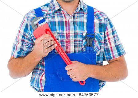 Cropped image of repairman holding monkey wrench on white background