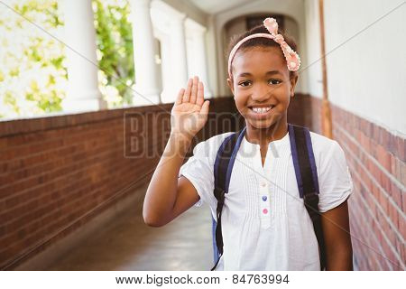 Portrait of cute little girl smiling in school corridor