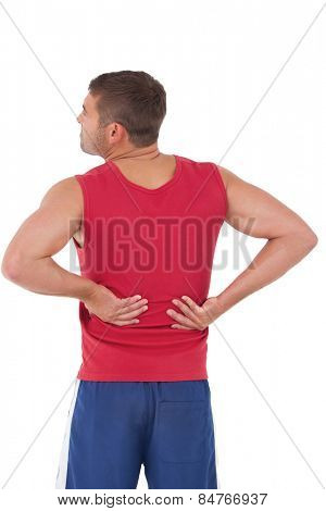 Fit man with injured back on white background