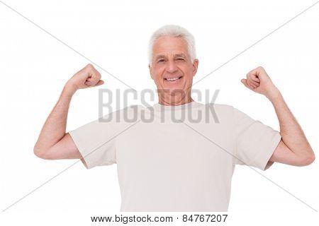 Senior man flexing his arms on white background