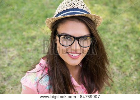 Pretty brunette smiling in park on a summers day