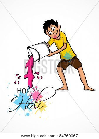 Cute little boy pouring color from a bucket on white background for Indian festival, Happy Holi celebration.