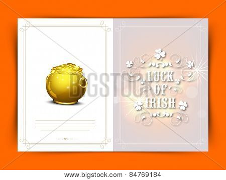 Elegant greeting card with text Luck of Irish and glossy golden pot full of coins for Happy St. Patrick's Day celebration.