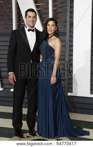 LOS ANGELES - FEB 22:  Aaron Rogers, Olivia Munn at the Vanity Fair Oscar Party 2015 at the Wallis Annenberg Center for the Performing Arts on February 22, 2015 in Beverly Hills, CA